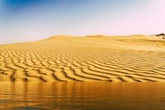 Mirage of the water in the Arabian desert stock photo