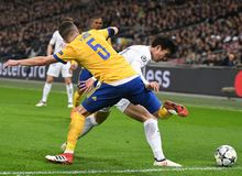 Miralem Pjanic and Heung-Min Son. Players pictured during the UEFA Champions League Round of 16 game between Tottenham Hotspur and Juventus Torino held on March Stock Photo