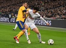 Miralem Pjanic and Heung-Min Son. Players pictured during the UEFA Champions League Round of 16 game between Tottenham Hotspur and Juventus Torino held on March Royalty Free Stock Photography