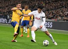 Miralem Pjanic and Heung-Min Son. Players pictured during the UEFA Champions League Round of 16 game between Tottenham Hotspur and Juventus Torino held on March Royalty Free Stock Photos