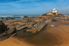Miramar Beach and Chapel Senhor da Pedra, Atlantic ocean near Stock Photos