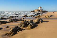 Miramar Beach Praia de Miramar and chapel Senhor da Pedra, near Porto, Portugal. ocean. Stock Photos
