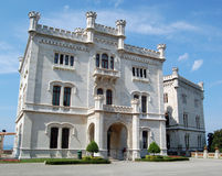 The Miramare Castle. Built in 1860 for the Austrian Archduke Maximilian and his wife is situated on the coast near Trieste, Italy Royalty Free Stock Photo