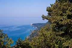 Miramare castle seen from above through the vegetation. Miramare castle in Trieste seen from above through the vegetation of the via Napoleonica Stock Photo