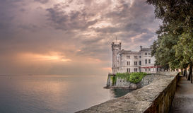 Miramare Castle at sunset, Trieste, Italy - Landscape. Miramare Castle in Trieste Italy (Gulf of Trieste), a white castle overhanging the sea built for Austrian royalty free stock photo