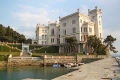 Miramare Castle in Trieste Italy. The Miramare Castle in Trieste Italy in an ornamental garden royalty free stock photography