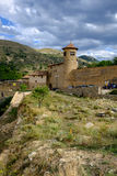 MIRAMBEL, SPAIN - AUGUST 16. MIRAMBEL, SPAIN - AUGUST 16: dramatic skies and landscape near the medieval walls of Mirambel on August 16, 2015 royalty free stock photography