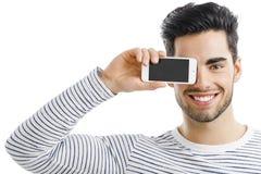 Mirando y mostrando algo en el teléfono Foto de archivo libre de regalías