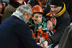Mircea Lucescu autographs child Stock Photo