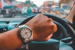 Mire el reloj después de trabajo Imagen de archivo