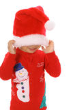 Mire a escondidas a un niño de la Navidad del abucheo Imagenes de archivo