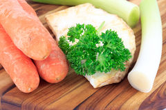 Mirepoix on wooden cutting board Stock Photo