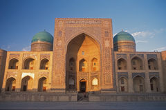 Miri Arab Madrassah in Bukhara at sunset. Stock Photos