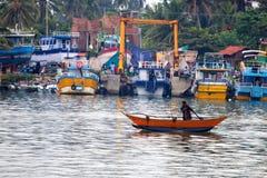 MIRISSA, SRI LANKA - 5 DECEMBER 2013: Fishermen in old motorboat in Sri Lanka. MIRISSA, SRI LANKA - 5 DECEMBER 2013: Beautiful view of fishermen in old motor royalty free stock photography
