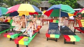 MIRISSA, SRI LANKA - MARCH 2014: Couple on deck chair on the beach in Mirissa. This small sandy tropical beach boasts some of Sri stock footage