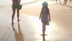MIRISSA, SRI LANKA - MARCH 2014: Little girl walking on a beach in Mirissa. This small sandy tropical beach boasts some of Sri Lan stock video