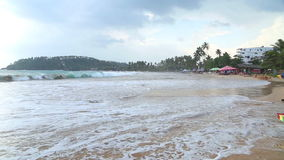MIRISSA, SRI LANKA - MARCH 2014: Stormy and cloudy weather on the beach in Mirissa. This small sandy tropical beach boasts some of. Sri Lanka�s best and most stock video