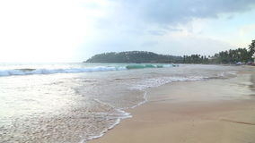 MIRISSA, SRI LANKA - MARCH 2014: Stormy and cloudy weather on the beach in Mirissa. This small sandy tropical beach boasts some of. Sri Lanka�s best and most stock video footage