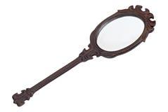 Miroir de main avec la trame en bois d'isolement photographie stock libre de droits