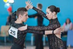 Mironchik Vladislav and Ermakova Olga Perform Juvenile-2 Latin-American Program. Minsk, Belarus –April 3, 2016: Mironchik Vladislav and Ermakova Olga Perform Stock Photo