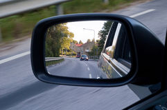 In the mirror. A picture in a rearview mirror, like looking back at something Royalty Free Stock Image