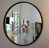 Mirror. Round Mirror on the wall royalty free stock images