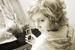Mirror. Vintage portrait of pretty girl with your things.(gems, mirror, clothes Stock Photo