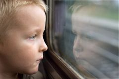 Mirror. Boy in train, face in mirror, reflection Stock Image