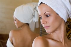 At the mirror. Girl looking at the mirror over the sholder, spa and wellness concept stock image