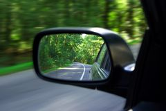 Mirror. Landscape in the sideview mirror of a speeding car Stock Photos