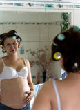 In the mirror. Pregnant woman in the mirror Royalty Free Stock Image