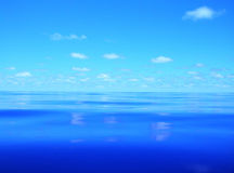 Mirror. Clouds contemplated in the blue of Atlantic Royalty Free Stock Photo