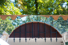 Mirror arch on the gate with metal bars Stock Images