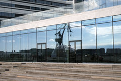 Mirror architecture. AARHUS, DENMARK – SEPTEMBER 18, 2016: Close to the new building with glass facade at the port of Aarhus– Aarhus will be European capital Royalty Free Stock Image