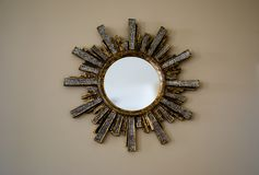 Mirror art piece on the wall. With brown background stock image
