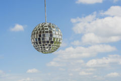 Mirror ball with a background as a beautiful sunny sky. Royalty Free Stock Image