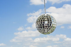 Mirror ball with a background as a beautiful sunny sky. Royalty Free Stock Photo
