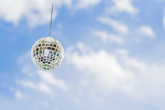 Mirror ball with a background as a beautiful sunny sky. Royalty Free Stock Photos