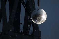 Illuminated mirror ball and crane stock photography