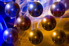 Mirror ball disco on the background-color illumination. Abstract Royalty Free Stock Image