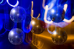 Mirror ball disco on the background-color illumination Stock Photo
