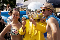 Mirror ball man posing for photos with two students. SZCZECIN, POLAND - MAY 23, 2014: Juwenalia, is an annual students' holiday in Poland, usually celebrated for Stock Photos