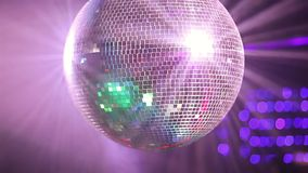 Mirror ball rolling in the night club stock video