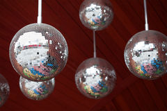 Mirror balls disco party abstract dark red background. shallow depth field.  Royalty Free Stock Photography