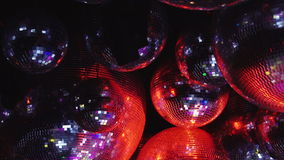 Mirror balls reflect rays of colored lights. stock video footage