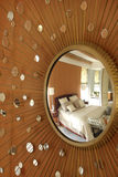 Mirror with beams and bedroom reflected royalty free stock photos