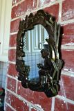 Mirror on the wall. Mirror on brick wall old royalty free stock image