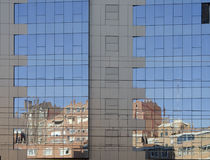 Mirror building. Old houses are reflected in the new building Stock Photography