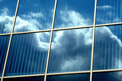 Mirror building. With clouds' reflection Stock Photos