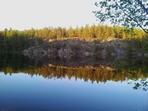 Mirror calm lake. Forest, water, mirroring Stock Photo